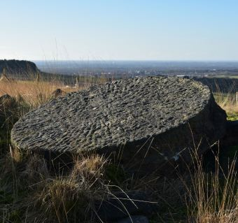 unfinished millstone above the quarries at white coppice
